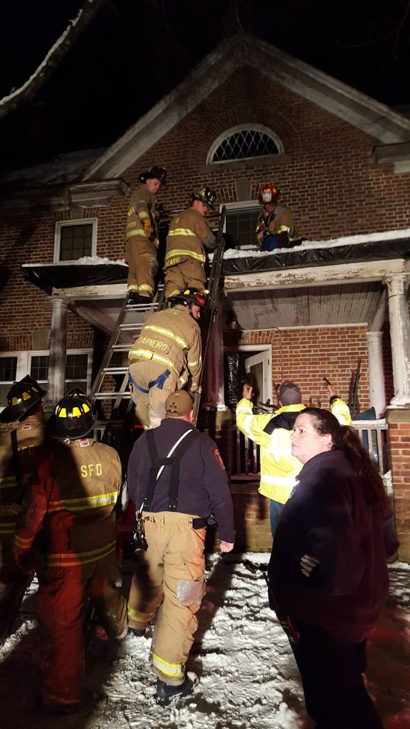 Members of the Seymour Fire Department work to rescue a patient that was in distress on the second floor of a home. The access from the interior was blocked and the patient needed to be removed from the window to the roof and down a ladder where he was placed in a waiting ambulance. This rescue is highly technical which members of the department are well trained in performing.